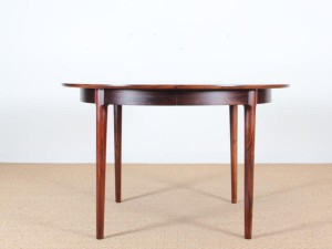 Mid-Century Modern danish extendable round dining table in Rio rosewood.