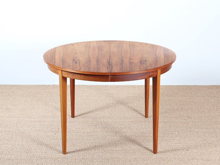 extendable round dining table in rosewood 4 to 8 seats
