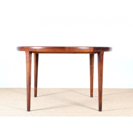 Extendable circular dining table in rio rosewood galerie for Table repas ronde extensible