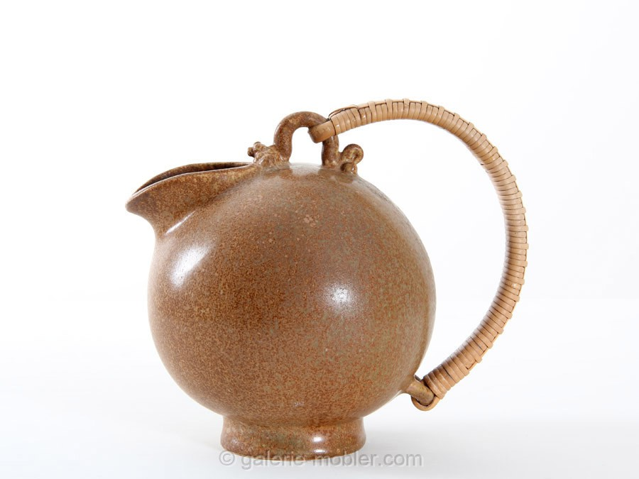 Scandinavian Pottery Pitcher With A Rattan Handle