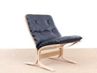 Mid modern century Siesta Classic armchair, low back by Ingmar Relling. New edition.